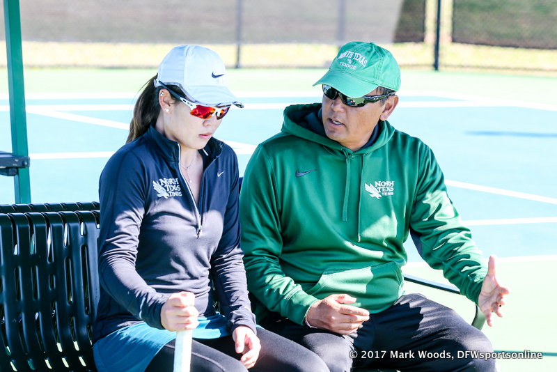 Sujay Lama coaches Minying Liang during a court change during the women's tennis match between North Texas and Nevada on February 25, 2017 at Waranch Tennis Complex in Denton, TX.
