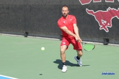 DALLAS, TX - MARCH 16: SMU women's tennis Assistant Coach Neil Kenner hits a backhand during the SMU women's tennis match vs Troy on March 16, 2018, at the SMU Tennis Complex, Turpin Stadium & Brookshire Family Pavilion in Dallas, TX. (Photo by George Walker/DFWsportsonline)