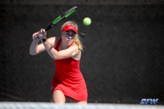 DALLAS, TX - MARCH 16: Nicole Petchey hits a backhand during the SMU women's tennis match vs Troy on March 16, 2018, at the SMU Tennis Complex, Turpin Stadium & Brookshire Family Pavilion in Dallas, TX. (Photo by George Walker/DFWsportsonline)