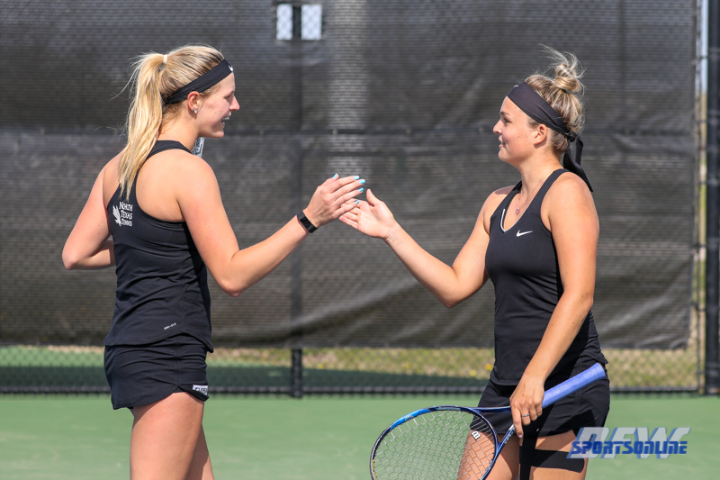 Denton, TX - March 17: Ivana Babić and Alexandra Héczey during the UNT Mean Green Women's Tennis dual match against Troy University at the Waranch Tennis Complex in Denton, TX. (Photo by Mark Woods/DFWsportsonline)