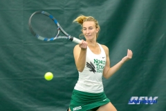 Plano, TX - April 14: Maria Kononova hits a forehand during the North Texas Women's Tennis dual match against the University of Arlington at the Lifetime Plano Tennis facility in Plano, TX. (Photo by Mark Woods/DFWsportsonline)