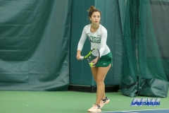 Plano, TX - April 14: Tamuna Kutubidze prepares to serve during the North Texas Women's Tennis dual match against the University of Arlington at the Lifetime Plano Tennis facility in Plano, TX. (Photo by Mark Woods/DFWsportsonline)