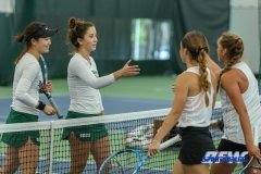 Plano, TX - April 14: Haruka Sasaki and Tamuna Kutubidze meet their opponents at the net after their 6-4 doubles match win during the North Texas Women's Tennis dual match against the University of Arlington at the Lifetime Plano Tennis facility in Plano, TX. (Photo by Mark Woods/DFWsportsonline)