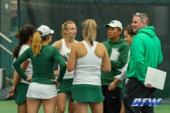 Plano, TX - April 14: Coaches Sujay Lama and Jeff Hammond meet with the team before the singles matches begin during the North Texas Women's Tennis dual match against the University of Arlington at the Lifetime Plano Tennis facility in Plano, TX. (Photo by Mark Woods/DFWsportsonline)