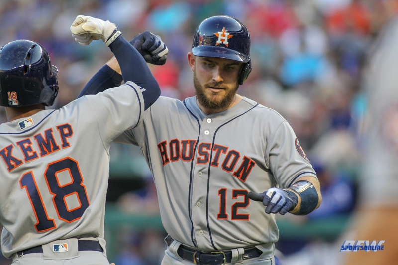 ARLINGTON, TX - JUNE 09: Houston Astros catcher Max Stassi (12) is congratulated by Houston Astros outfielder Tony Kemp (18) after hitting a home run during the game between the Texas Rangers and the Houston Astros on June 9, 2018 at Globe Life Park in Arlington, TX. (Photo by George Walker/Icon Sportswire)