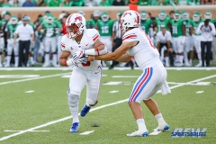 DENTON, TX - SEPTEMBER 01: SMU quarterback Ben Hicks (8) hands the ball off to running back Xavier Jones (5) during the game between North Texas and SMU on September 1, 2018 at Apogee Stadium in Denton, TX. (Photo by Mark Woods/DFWsportsonline)