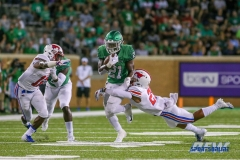 DENTON, TX - SEPTEMBER 01: UNT running back Nic Smith (21) advances the ball during the game between North Texas and SMU on September 1, 2018 at Apogee Stadium in Denton, TX. (Photo by Mark Woods/DFWsportsonline)