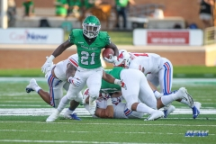 DENTON, TX - SEPTEMBER 01: North Texas Mean Green running back Nic Smith (21) runs up the middle during the game between North Texas and SMU on September 1, 2018 at Apogee Stadium in Denton, TX. (Photo by George Walker/Icon Sportswire)