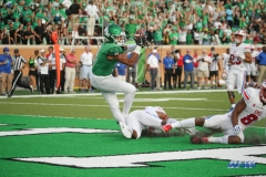 DENTON, TX - SEPTEMBER 01: North Texas Mean Green wide receiver Jalen Guyton (9) catches a touchdown pass during the game between North Texas and SMU on September 1, 2018 at Apogee Stadium in Denton, TX. (Photo by George Walker/Icon Sportswire)