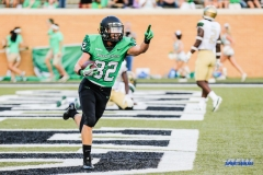 DENTON, TX - SEPTEMBER 23: UNT WIDE RECEIVER MICHAEL LAWRENCE (32) CELEBRATES HIS TOUCHDOWN DURING THE GAME BETWEEN THE UNT MEAN GREEN AND UAB BLAZERS ON SEPTEMBER 23, 2017, AT APOGEE STADUIM IN DENTON, TEXAS. (PHOTO BY MARK WOODS/DFWSPORTSONLINE)