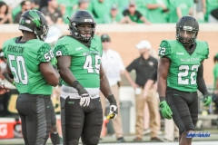 DENTON, TX - SEPTEMBER 23: UNT LINEBACKER LADARIUS HAMILTON (50), DEFENSIVE TACKLE RODERICK YOUNG (49), AND LINEBACKER E. J. EJIYA (22) DURING THE GAME BETWEEN THE UNT MEAN GREEN AND UAB BLAZERS ON SEPTEMBER 23, 2017, AT APOGEE STADUIM IN DENTON, TEXAS. (PHOTO BY MARK WOODS/DFWSPORTSONLINE)
