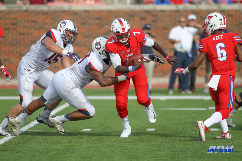 DALLAS, TX - SEPTEMBER 30: Southern Methodist Mustangs quarterback D.J. Gillins (7) is under pressure during the game between SMU and UConn on September 30, 2017, at Gerald J. Ford Stadium in Dallas, TX. (Photo by George Walker/Icon Sportswire)