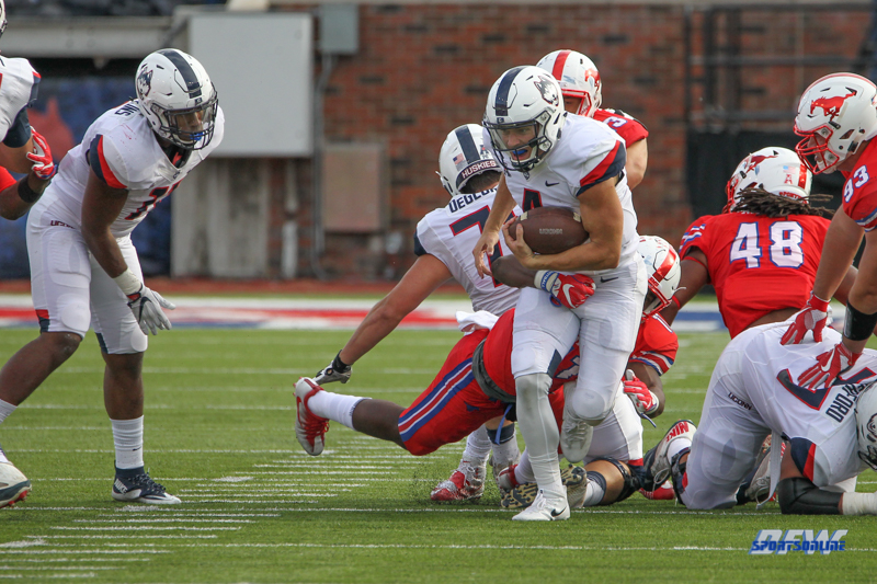 DALLAS, TX - SEPTEMBER 30: Connecticut Huskies quarterback Bryant Shirreffs (4) is sacked by Southern Methodist Mustangs linebacker Kyran Mitchell (11) during the game between SMU and UConn on September 30, 2017, at Gerald J. Ford Stadium in Dallas, TX. (Photo by George Walker/Icon Sportswire)