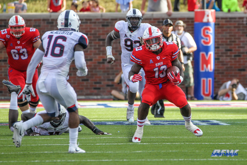 DALLAS, TX - SEPTEMBER 30: Southern Methodist Mustangs running back Ke'Mon Freeman (13) tries to avoid Connecticut Huskies defensive back Brice McAllister (16) during the game between SMU and UConn on September 30, 2017, at Gerald J. Ford Stadium in Dallas, TX. (Photo by George Walker/Icon Sportswire)