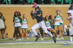 DENTON, TX - OCTOBER 14: North Texas Mean Green wide receiver Jalen Guyton (9) catches a pass for a touchdown during the game between the North Texas Mean Green and UTSA Roadrunners on October 14, 2017, at Apogee Stadium in Denton, Texas. (Photo by George Walker/DFWsportsonline)