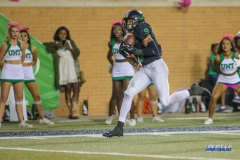 DENTON, TX - OCTOBER 14: North Texas Mean Green wide receiver Jalen Guyton (9) makes a catch for a touchdown during the game between the North Texas Mean Green and UTSA Roadrunners on October 14, 2017, at Apogee Stadium in Denton, Texas. (Photo by George Walker/DFWsportsonline)