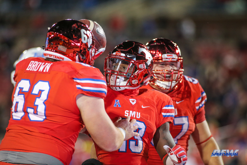 DALLAS, TX - OCTOBER 27: Southern Methodist Mustangs offensive lineman Evan Brown (63) celebrates with Southern Methodist Mustangs running back Ke'Mon Freeman (13) after a touchdown during the game between SMU and Tulsa on October 27, 2017, at Gerald J. Ford Stadium in Dallas, TX. (Photo by George Walker/DFWsportsonline)