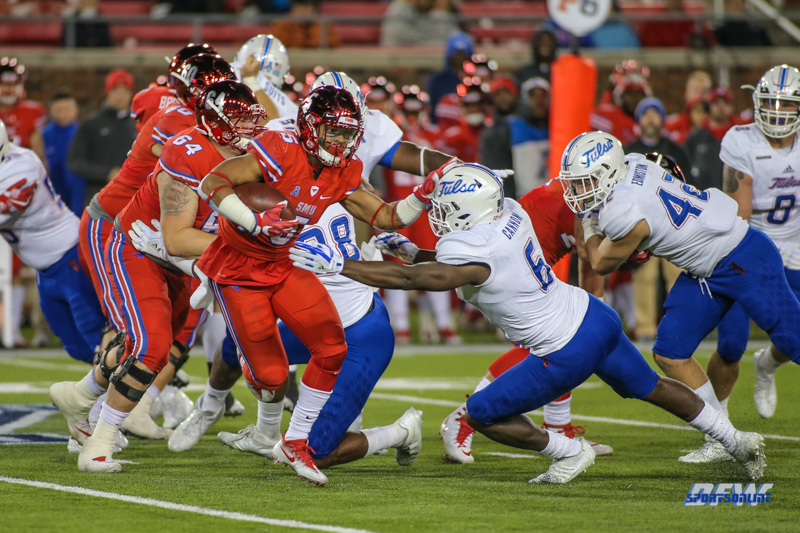 DALLAS, TX - OCTOBER 27: Southern Methodist Mustangs running back Xavier Jones (5) fights for yards during the game between SMU and Tulsa on October 27, 2017, at Gerald J. Ford Stadium in Dallas, TX. (Photo by George Walker/Icon Sportswire)