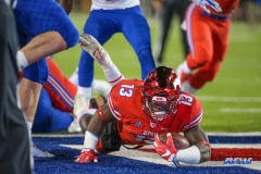 DALLAS, TX - OCTOBER 27: Southern Methodist Mustangs running back Ke'Mon Freeman (13) dives into the end zone for a touchdown during the game between SMU and Tulsa on October 27, 2017, at Gerald J. Ford Stadium in Dallas, TX. (Photo by George Walker/DFWsportsonline)