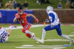DALLAS, TX - OCTOBER 27: Southern Methodist Mustangs wide receiver Trey Quinn (18) tries to avoid Tulsa Golden Hurricane cornerback Keidrien Wadley (11) during the game between SMU and Tulsa on October 27, 2017, at Gerald J. Ford Stadium in Dallas, TX. (Photo by George Walker/Icon Sportswire)