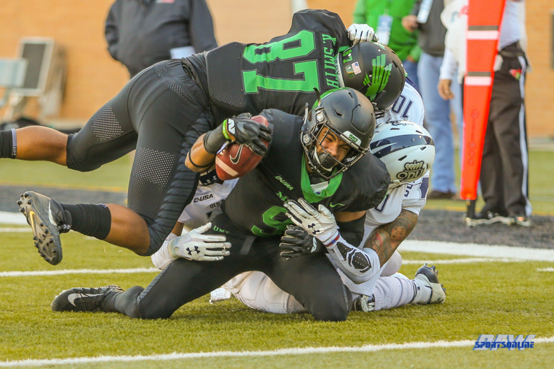 DENTON, TX - OCTOBER 28: North Texas Mean Green wide receiver Jalen Guyton (9) is brought down short of the goal line during the game between the North Texas Mean Green and Old Dominion Monarchs on October 28, 2017, at Apogee Stadium in Denton, Texas. (Photo by George Walker/DFWsportsonline)