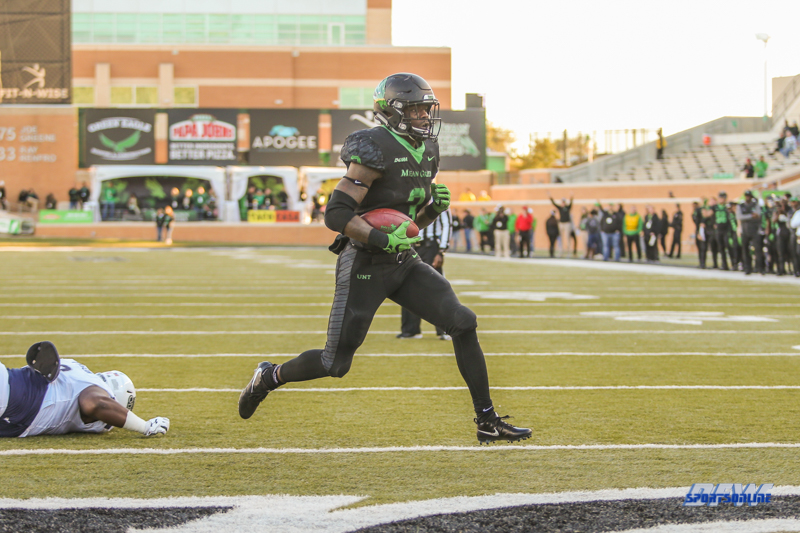 DENTON, TX - OCTOBER 28: North Texas Mean Green running back Jeffery Wilson (3) scores a touchdown during the game between the North Texas Mean Green and Old Dominion Monarchs on October 28, 2017, at Apogee Stadium in Denton, Texas. (Photo by George Walker/DFWsportsonline)