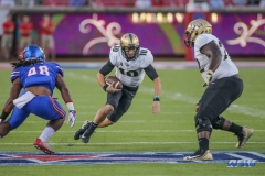 DALLAS, TX - NOVEMBER 04: UCF Knights quarterback McKenzie Milton (10) runs for a first down during the game between SMU and UCF on November 4, 2017, at Gerald J. Ford Stadium in Dallas, TX. (Photo by George Walker/Icon Sportswire)
