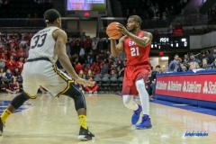 UNIVERSITY PARK, TX - NOVEMBER 10: Southern Methodist Mustangs guard Ben Emelogu II (21) looks to pass during the men's basketball game between SMU and UMBC on November 10, 2017, at Moody Coliseum in Dallas, TX.(Photo by George Walker/Icon Sportswire)