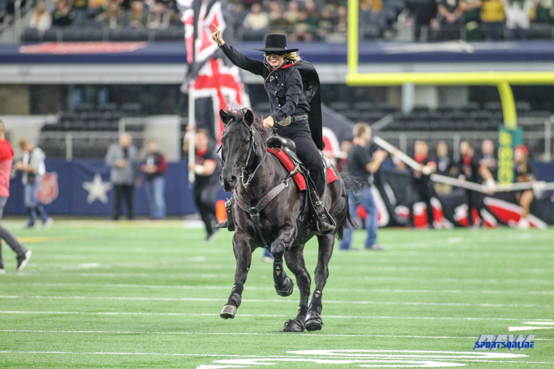 ARLINGTON, TX - NOVEMBER 11: Texas Tech Masked Rider leads the team onto the field before the game between Baylor and Texas Tech on November 11, 2017 at AT&T Stadium in Arlington, Texas. (Photo by George Walker/Icon Sportswire)