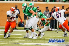 Denton, TX - November 11: North Texas Mean Green quarterback Mason Fine (6) with offensive linemen T.J. Henson (53) and Riley Mayfield (79) during the game between the North Texas Mean Green and UTEP Miners (Photo by Mark Woods/DFWsportsonline)