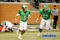 Denton, TX - November 11: North Texas Mean Green quarterback Mason Fine (6) with offensive lineman T.J. Henson (53) during the game between the North Texas Mean Green and UTEP Miners (Photo by Mark Woods/DFWsportsonline)