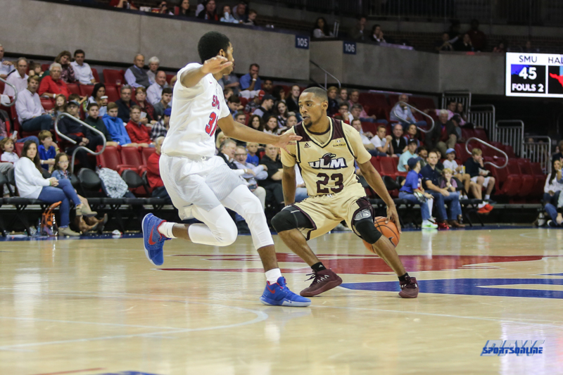 DALLAS, TX - NOVEMBER 12: Louisiana Monroe Warhawks guard Jordon Harris (23) dribbles behind his back during the game between SMU and ULM on November 12, 2017 at Moody Coliseum in Dallas, TX. (Photo by George Walker/Icon Sportswire)