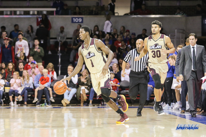 DALLAS, TX - NOVEMBER 12: Louisiana Monroe Warhawks forward Travis Munnings (1) brings the ball up court during the game between SMU and ULM on November 12, 2017 at Moody Coliseum in Dallas, TX. (Photo by George Walker/Icon Sportswire)