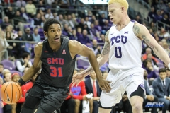 FORT WORTH, TX - DECEMBER 05: Southern Methodist Mustangs guard Jimmy Whitt (31) drives to the basket during the game between SMU and TCU on December 5, 2017 at the Ed and Rae Schollmaier Arena in Fort Worth, TX. (Photo by George Walker/DFWsportsonline