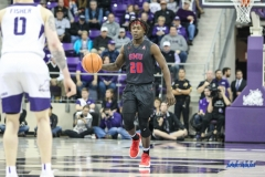 FORT WORTH, TX - DECEMBER 05: Southern Methodist Mustangs guard Elijah Landrum (20) brings the ball up court during the game between SMU and TCU on December 5, 2017 at the Ed and Rae Schollmaier Arena in Fort Worth, TX. (Photo by George Walker/DFWsportsonline