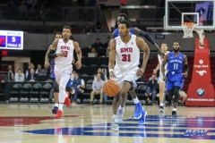 DALLAS, TX - DECEMBER 13: Southern Methodist Mustangs guard Jimmy Whitt (31) brings the ball up court during the men's basketball game between SMU and New Orleans on December 13, 2017, at Moody Coliseum, in Dallas, TX. (Photo by George Walker/DFWsportsonline)