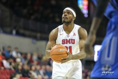 DALLAS, TX - DECEMBER 13: Southern Methodist Mustangs guard Ben Emelogu II (21) shoots a free throw during the men's basketball game between SMU and New Orleans on December 13, 2017, at Moody Coliseum, in Dallas, TX. (Photo by George Walker/DFWsportsonline)