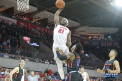 UNIVERSITY PARK, TX - DECEMBER 18: Southern Methodist Mustangs guard Ben Emelogu II (21) goes to the basket during the game between SMU and Boise State on December 18, 2017, at Moody Coliseum in Dallas, TX. (Photo by George Walker/DFWsportsonline)