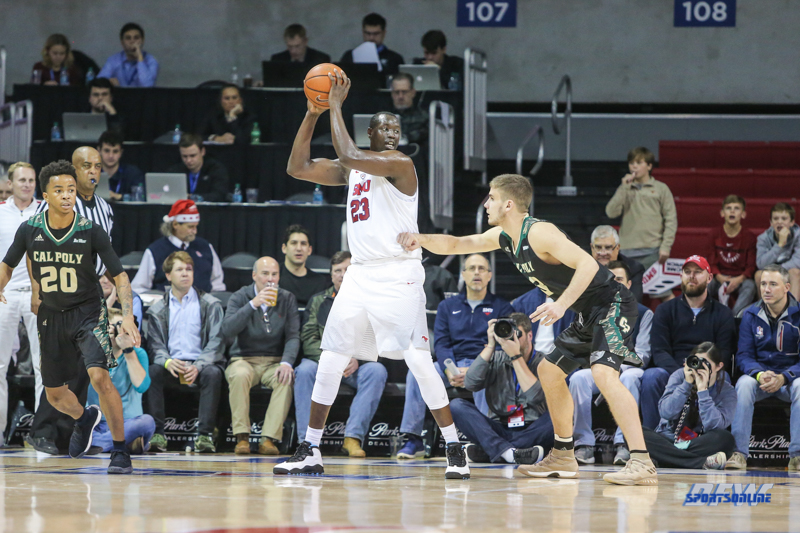 UNIVERSITY PARK, TX - DECEMBER 19: Southern Methodist Mustangs forward Akoy Agau (23) looks to pass the ball during the game between SMU and Cal Poly on December 19, 2017, at Moody Coliseum in Dallas, TX. (Photo by George Walker/Icon Sportswire)