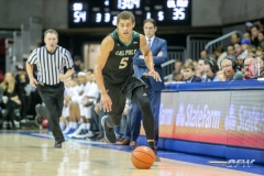 UNIVERSITY PARK, TX - DECEMBER 19: Cal Poly Mustangs forward Mark Crowe (5) brings the ball up court during the game between SMU and Cal Poly State on December 19, 2017, at Moody Coliseum in Dallas, TX. (Photo by George Walker/DFWsportsonline)