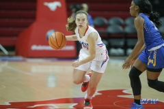 UNIVERSITY PARK, TX - DECEMBER 22: Southern Methodist Mustangs guard Morgan Smith (12) brings the ball up court during the women's game between SMU and McNeese State on December 22, 2017, at Moody Coliseum in Dallas, TX. (Photo by George Walker/Icon Sportswire)