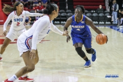 UNIVERSITY PARK, TX - DECEMBER 22: McNeese State Cowgirls guard Dede Sheppard (4) drives to the basket during the women's game between SMU and McNeese State on December 22, 2017, at Moody Coliseum in Dallas, TX. (Photo by George Walker/Icon Sportswire)