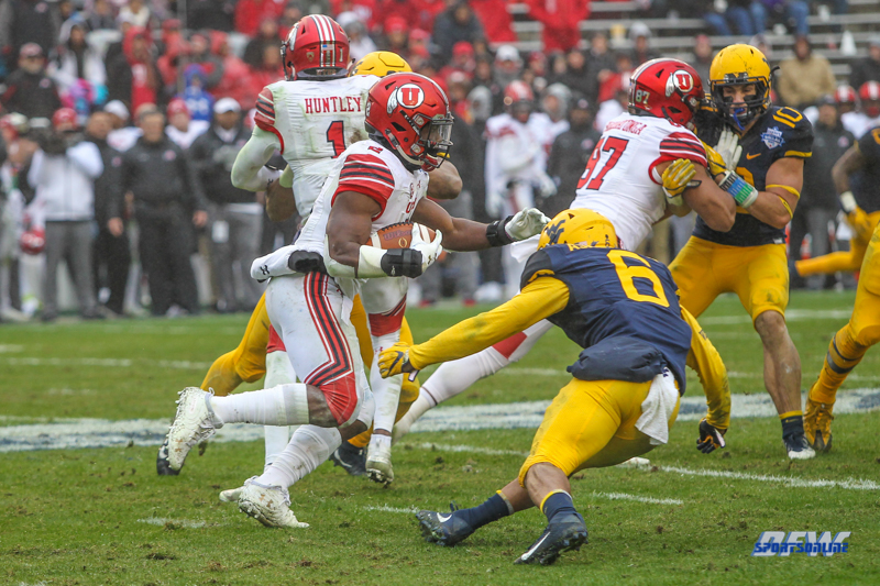 DALLAS, TX - DECEMBER 26: Utah Utes running back Zack Moss (2) runs into the line during the Zaxby's Heart of Dallas Bowl game between Utah and West Virginia on December 26, 2017, at Cotton Bowl Stadium in Dallas, TX. (Photo by George Walker/DFWsportsonline)