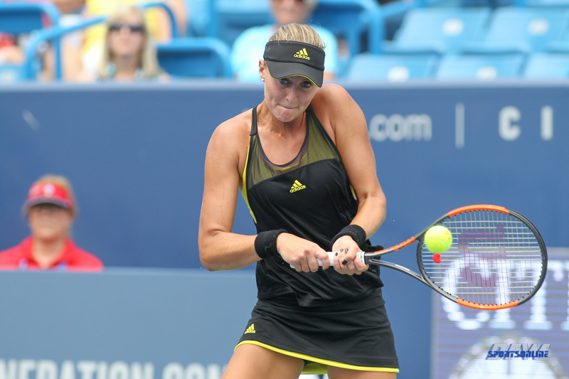 CINCINNATI, OH - AUGUST 14: Kristina Mladenovic (FRA) hits a backhand during the Western & Southern Open at the Lindner Family Tennis Center in Mason, Ohio on August 14, 2017. (Photo by George Walker/Icon Sportswire)
