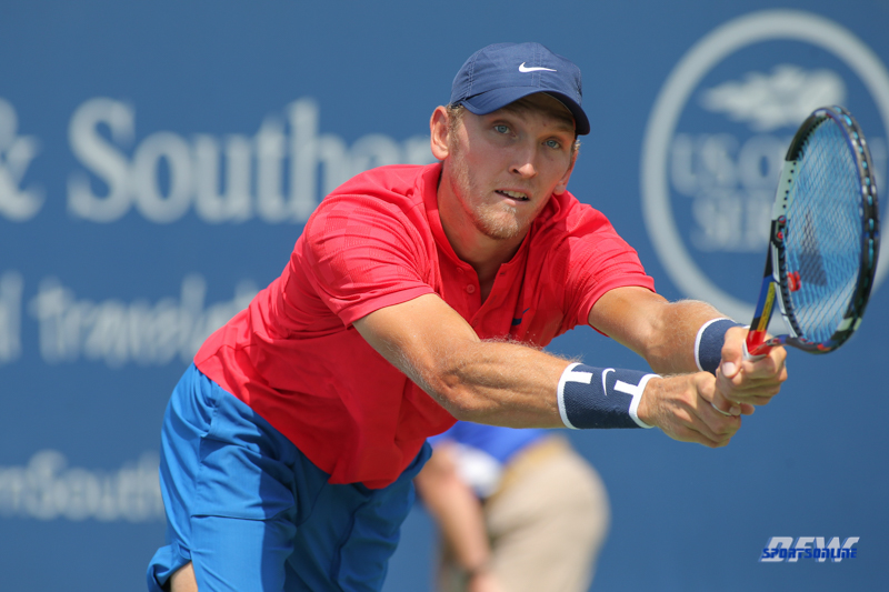 CINCINNATI, OH - AUGUST 16: Mitchell Krueger (USA) stretches for a backhand during the Western & Southern Open at the Lindner Family Tennis Center in Mason, Ohio on August 16, 2017.(Photo by George Walker/Icon Sportswire)