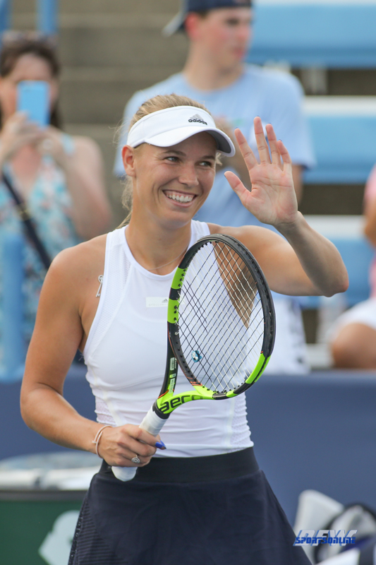 CINCINNATI, OH - AUGUST 16: Caroline Wozniacki (DEN) waves to the crowd during the Western & Southern Open at the Lindner Family Tennis Center in Mason, Ohio on August 16, 2017.(Photo by George Walker/Icon Sportswire)