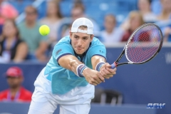 CINCINNATI, OH - John Isner (USA) stretches for a backhand during the Western & Southern Open at the Lindner Family Tennis Center in Mason, Ohio on August 13, 2017, (Photo by George Walker/DFWsportsonline
