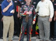 Jeff Gordon is presented a Berretta shotgun after winning the pole for the 2009 Dickies 500 at Texas Motor Speedway. Photo by George Walker.